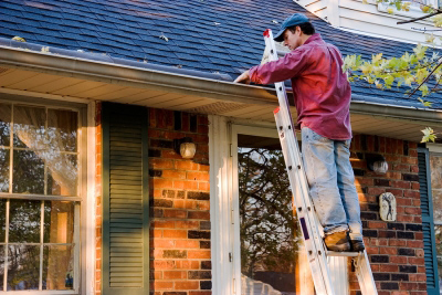 man fixing gutters