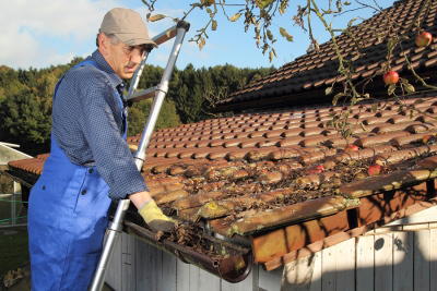man cleaning gutters